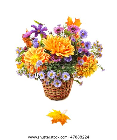bouquet of autumn flowers in basket - stock photo