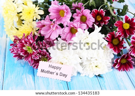 Bouquet of beautiful chrysanthemums on table close-up - stock photo