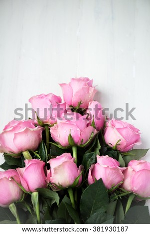Bouquet of Beautiful Pink Roses on White Wooden Background, shallow DOF, selective focus - stock photo