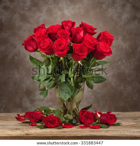 Bouquet of beautiful roses in a dramatic light. - stock photo
