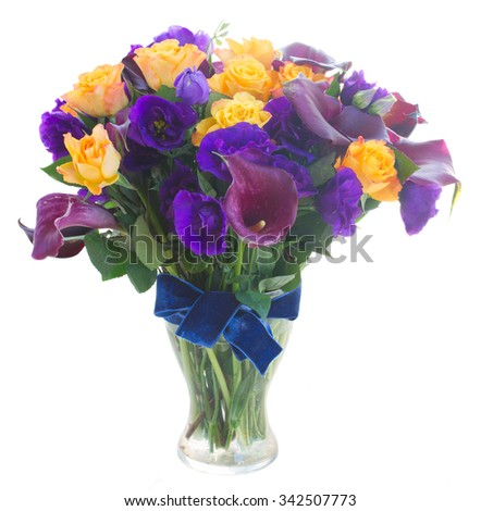 Bouquet of calla lilly, roses and eustoma flowers in glass vase isolated on white background - stock photo