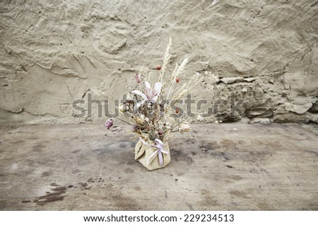 Bouquet of dried flowers, detail of a decorative flowers on a wooden table - stock photo