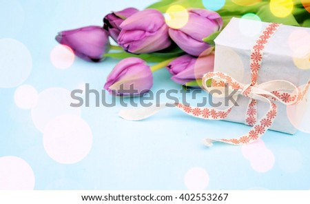 bouquet of flowers and a gift, a romantic concept. toned photo - stock photo
