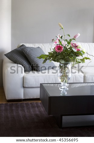 bouquet of flowers in modern white living room - stock photo