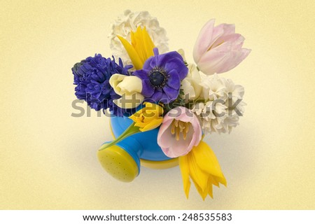 bouquet of flowers in pediatric plastic watering top view. picture in retro style - stock photo