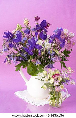 bouquet of flowers iris and aquilegia - stock photo