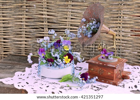 Bouquet of flowers with gramophone, phonograph on lace - stock photo