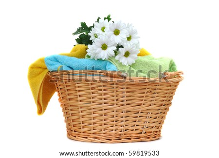 Bouquet of fresh daisies on a pile of fresh towels - stock photo