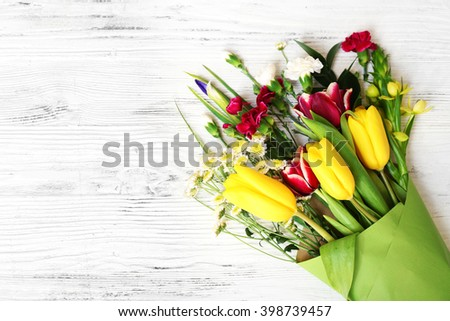 Bouquet of fresh flowers on the white table. Top view. - stock photo
