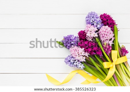 Bouquet of hyacinth flowers on white wooden background. Top view, copy space - stock photo