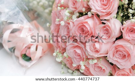 Bouquet of light pink roses on white table, close up - stock photo
