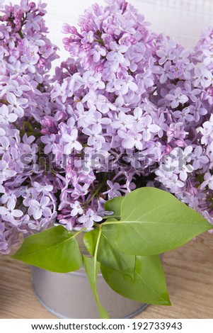 bouquet of lilac flowers on wooden background - stock photo