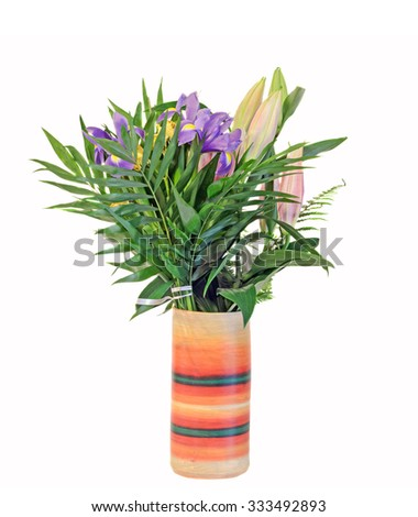 Bouquet of mauve Iris flowers with lilies buds in a vibrant colored vase, floral arrangement, close up, isolated, white background. - stock photo