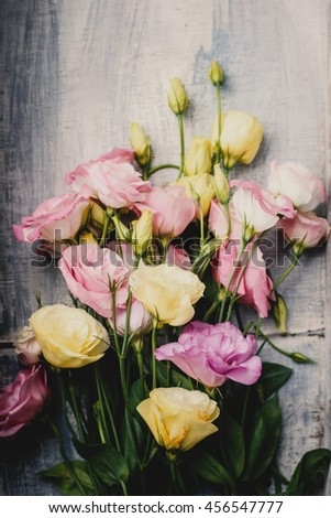 Bouquet of pink and yellow lisianthus. - stock photo