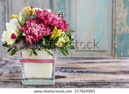 Bouquet of pink carnations and yellow alstroemeria (Peruvian lily or Lily of the Incas) flowers - stock photo