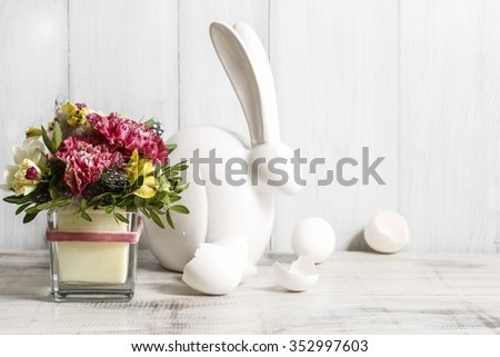 Bouquet of pink carnations and yellow alstroemeria (Peruvian lily or Lily of the Incas) flowers on white wooden background - stock photo