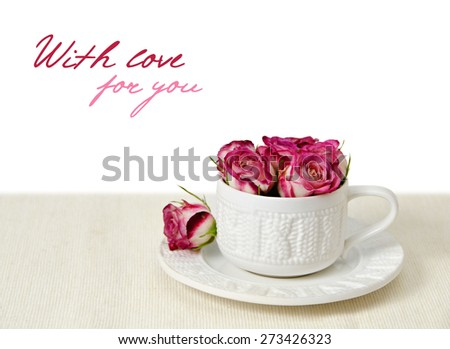 bouquet of pink roses in a white cup on a  beige cotton - stock photo