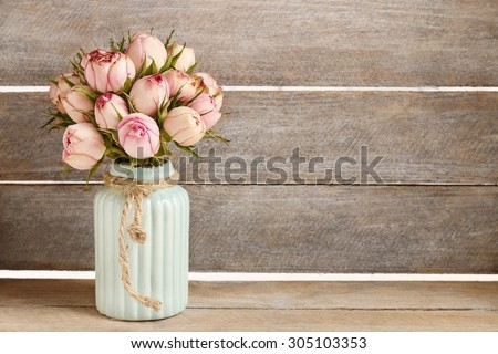 Bouquet of pink roses in turquoise ceramic vase, copy space - stock photo