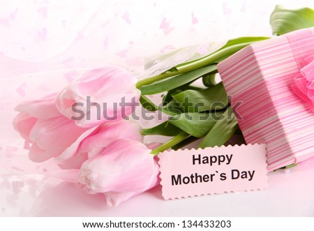 Bouquet of pink tulips and gift for Mother's Day - stock photo