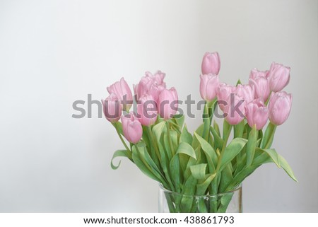 Bouquet of pink tulips in a vase - stock photo