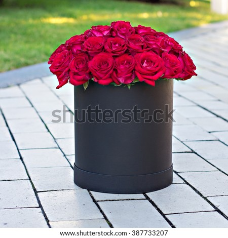 Bouquet of red roses in a box - stock photo