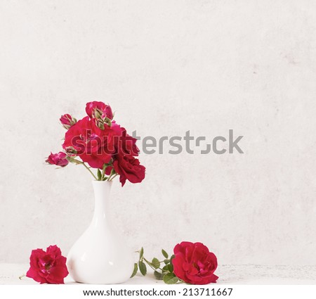 bouquet of red roses in vase - stock photo