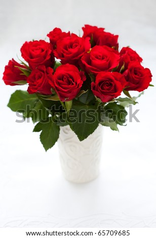 bouquet of red roses in vase on the white background - stock photo
