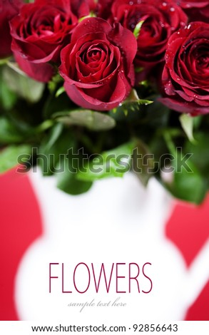 bouquet of red roses in vase (with sample text) - stock photo