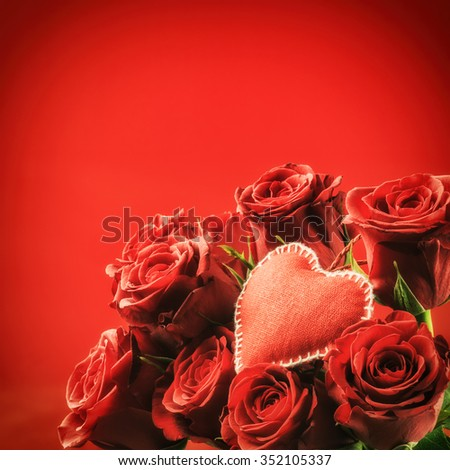 Bouquet of red roses with decorative heart. St Valentine's concept with copy space - stock photo