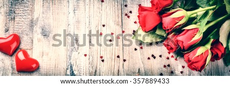 Bouquet of red roses with decorative hearts. St Valentine's concept with copy space - stock photo