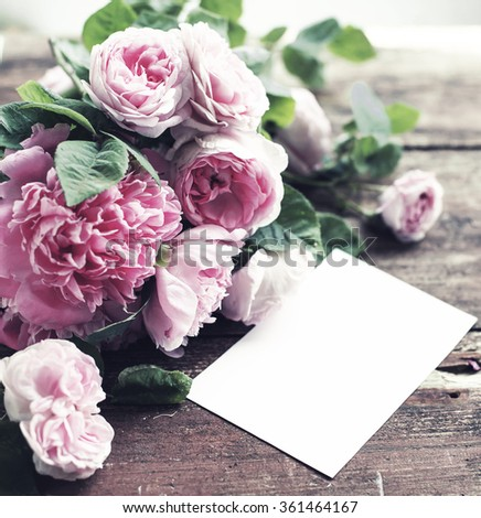 bouquet of roses and peonies on wooden board, Valentines Day background - stock photo