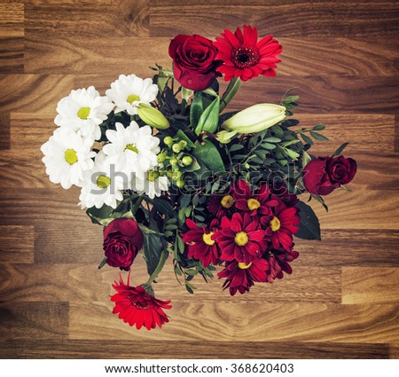 Bouquet of roses, gerberas, lilies and chrysanthemums. Valentine's Day. Symbol of love. - stock photo