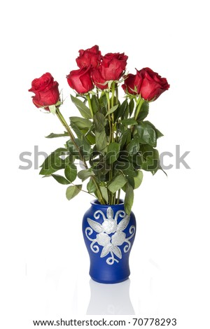 Bouquet of roses in a blue vase against white background - stock photo