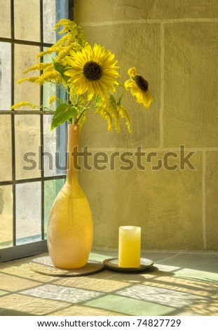 bouquet of summer flowers in front of a sunlit window - stock photo