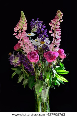 bouquet of summer flowers on black - stock photo