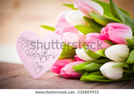 bouquet of tulips and a heart with the message Happy Valentines Day - stock photo