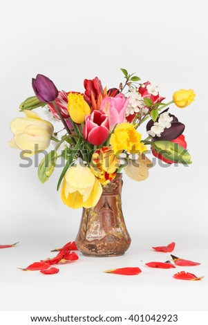 Bouquet of tulips in a vase isolated on white - stock photo