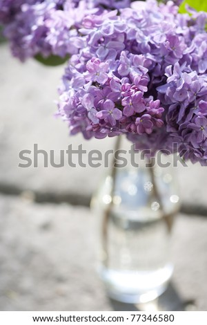 Bouquet of violet lilac in a vase - stock photo