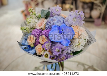 Bouquet of white and blue flower   on table - stock photo