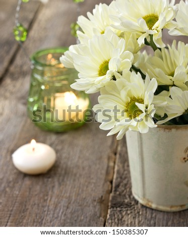 Bouquet of white chrysanthemums in a vase on a wooden background - stock photo