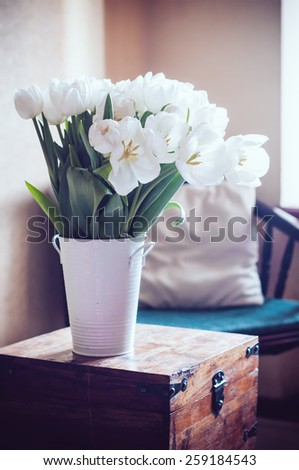 Bouquet of white tulips in the interior, room decor - stock photo