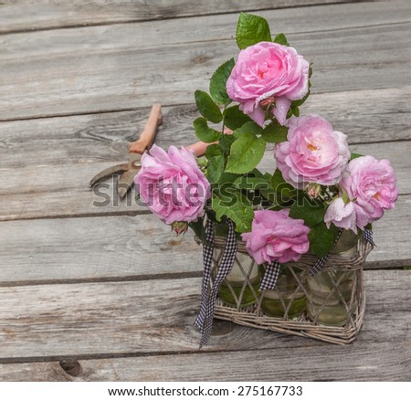 Bouquet of wild rose in vintage style on a wooden  table - stock photo