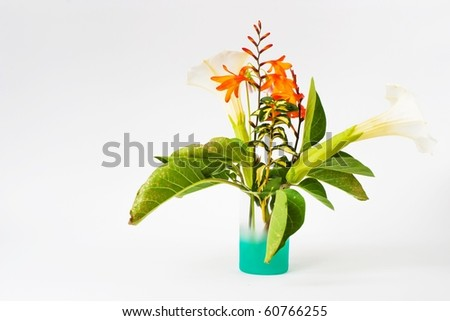 bouquet standing on the white table, isolated background - stock photo