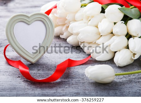Bouquet white tulips with red ribbon.Flowers of spring and love.Happy Mothers Day.Copy space.selective focus. - stock photo