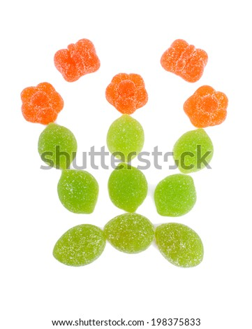 Bouquet with batterflies made from jelly candies, isolated on white - stock photo