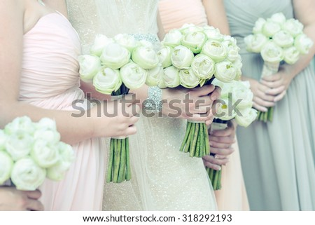 bouquets in females hand, selective focus. - stock photo