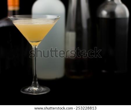 Bourbon Sidecar is a cocktail that contains bourbon, triple sec and lemon juice - stock photo
