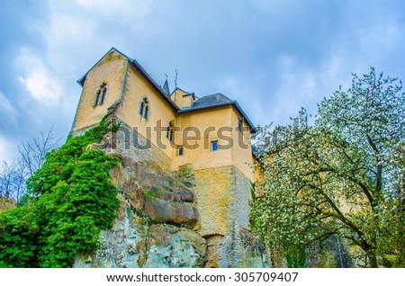 bourlingster village in luxembourg is surrounded by lush forest and its highlist is old castle transformed into cozy restaurant. - stock photo
