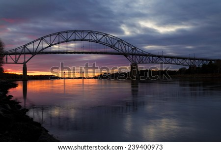 Bourne Bridge in Cape Cod at Sunset - stock photo