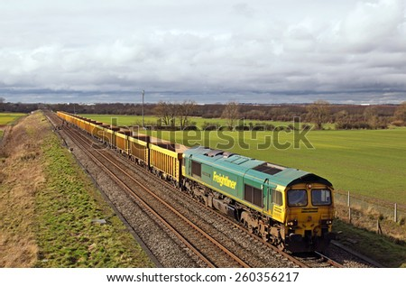 BOURTON, UK - FEBRUARY 24: An FLT operated engineers train returns to depot having unloaded its ballast on February 24, 2014 in Bourton. FLT founded in 1995 has an operating revenue of approx £360Mn - stock photo